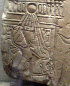 640px-NefertitiRelief_SmitingSceneOnBoat-CloseUp
